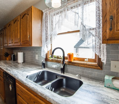 Standard Kitchen Sink with granite countertops and cabinetry