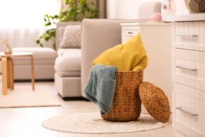yellow blanket stored in basket