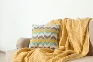 yellow throw blanket on couch