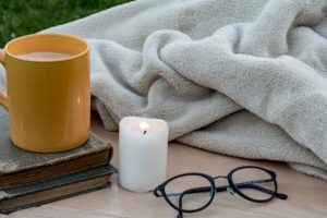 Gray Sherpa Blanket With Glasses and Candle
