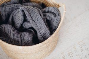 crochet blanket is laundry basket