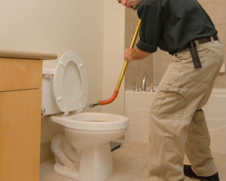 Plumber Using Toilet Auger