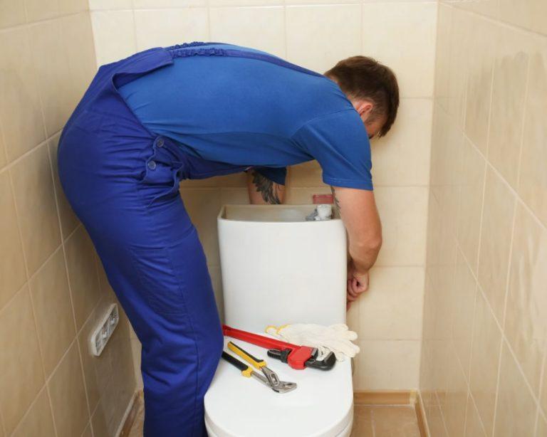 Plumber Using Toilet Repair Kit