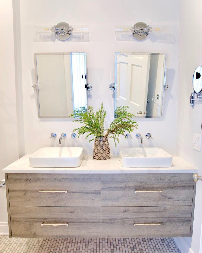 neutral coastal bathroom with plant Bathroom Lighting Ideas