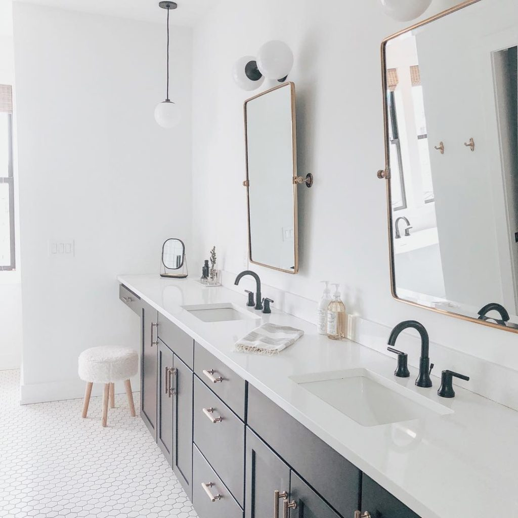 farmhouse bathroom with white hexagon floor and black and gold accents Bathroom Lighting Ideas