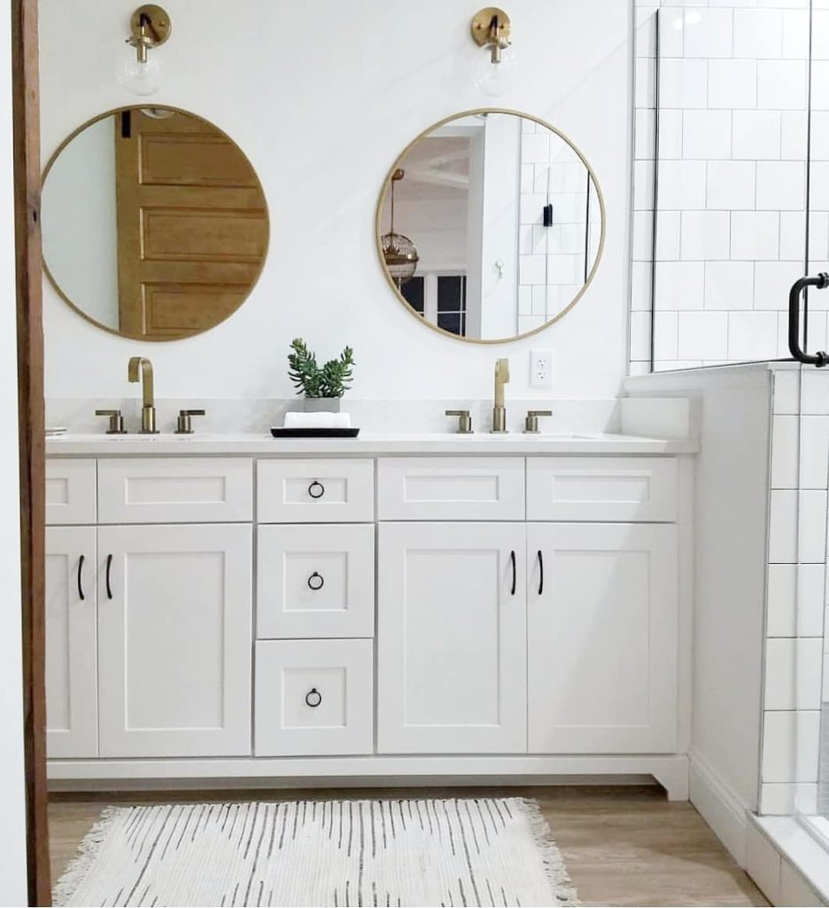 bathroom with white vanity and gold accents Bathroom Lighting Ideas