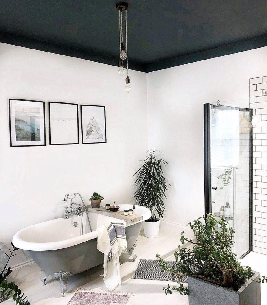 bathroom with vintage bulbs hanging and subway tile Bathroom Lighting Ideas