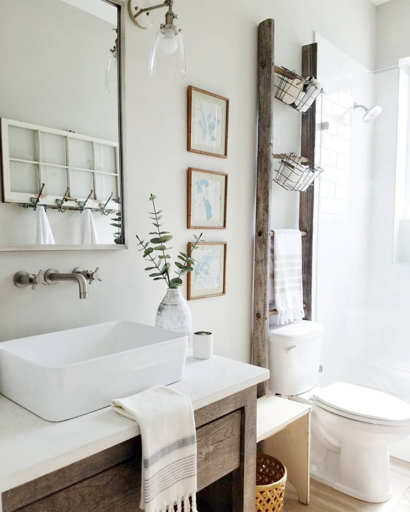 neutral farmhouse bathroom with blanket ladder Bathroom Lighting Ideas