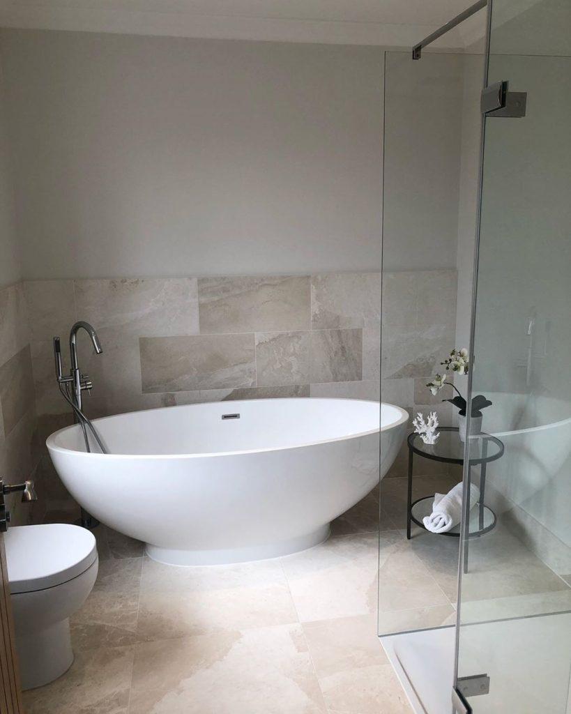 bathroom with stone floor running up the walls Bathroom Lighting Ideas