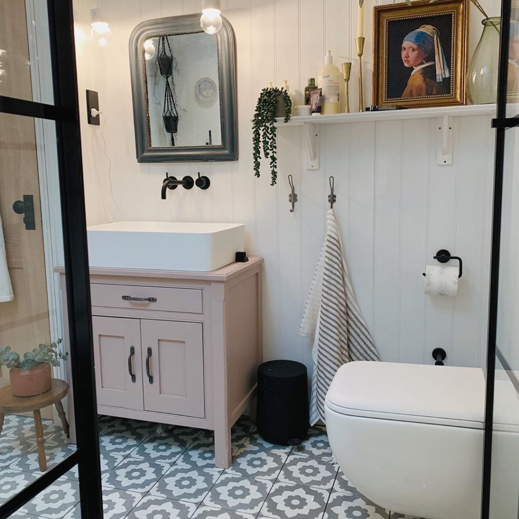 shabby chic bathroom with light pink vanity and white toilet Bathroom Lighting Ideas