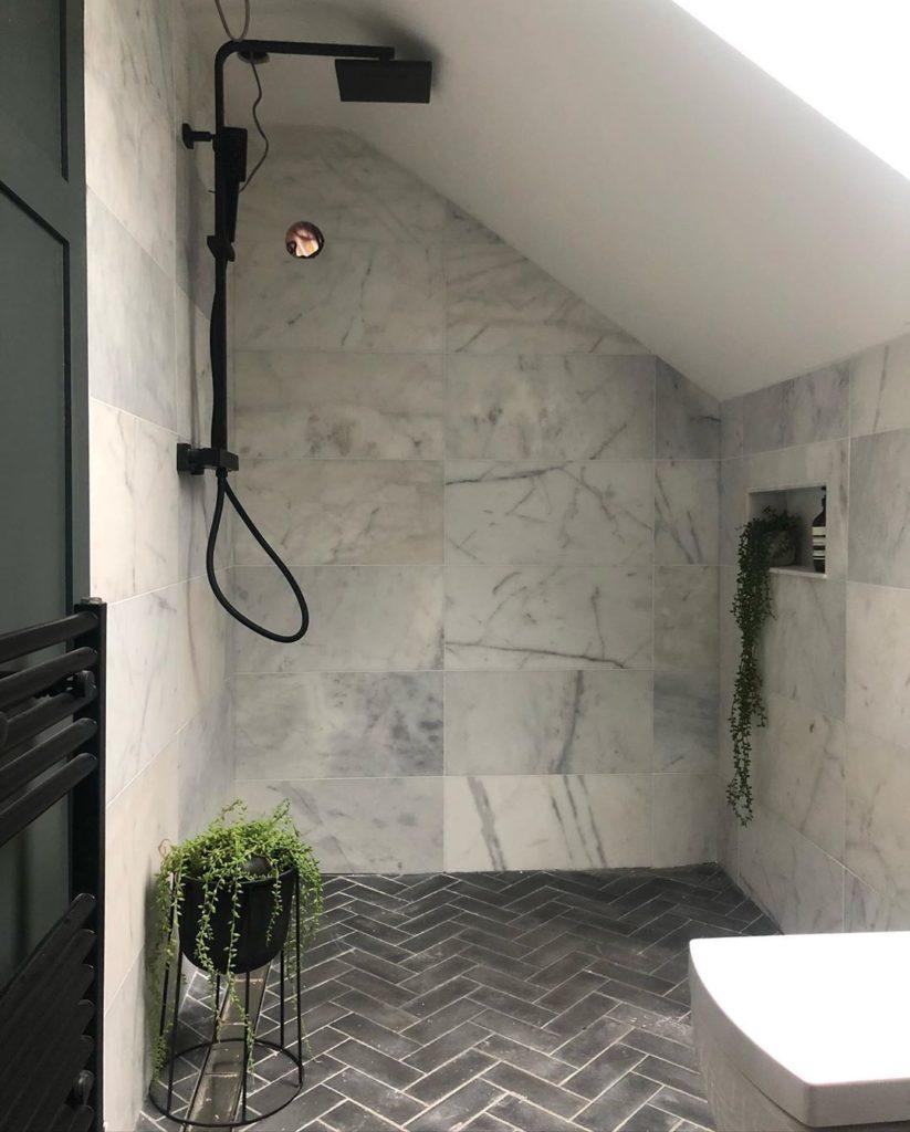 gray bathroom with matte black shower fixture Bathroom Lighting Ideas