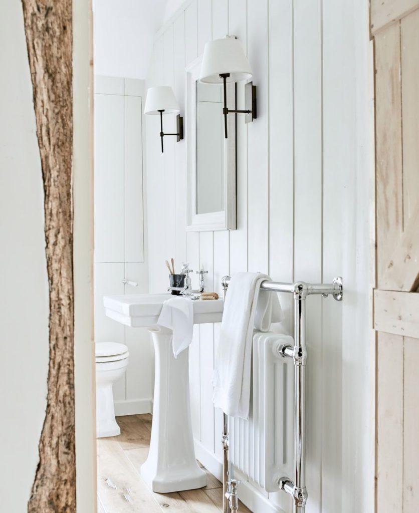 bathroom with vertical shiplap walls and free standing vanity  Bathroom Lighting Ideas