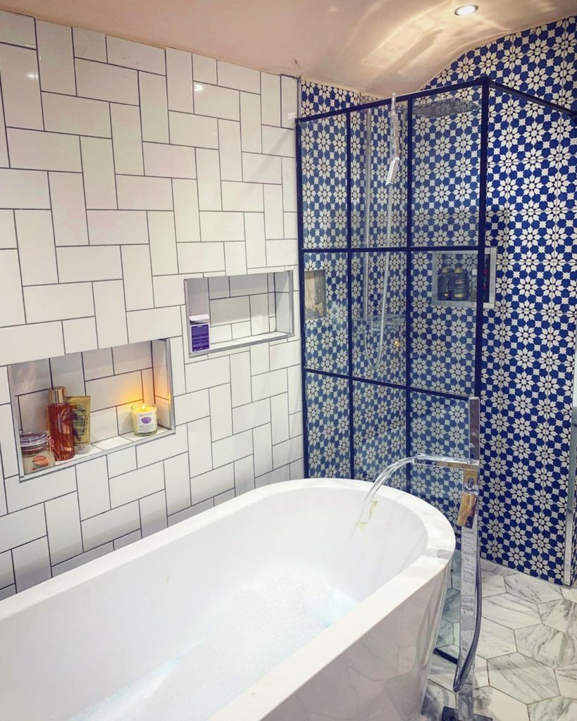bathroom with unique subway tile and built in shelves Bathroom Lighting Ideas