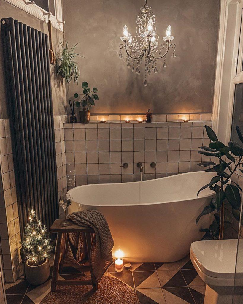 bathtub with chandelier and gray wall Bathroom Lighting Ideas