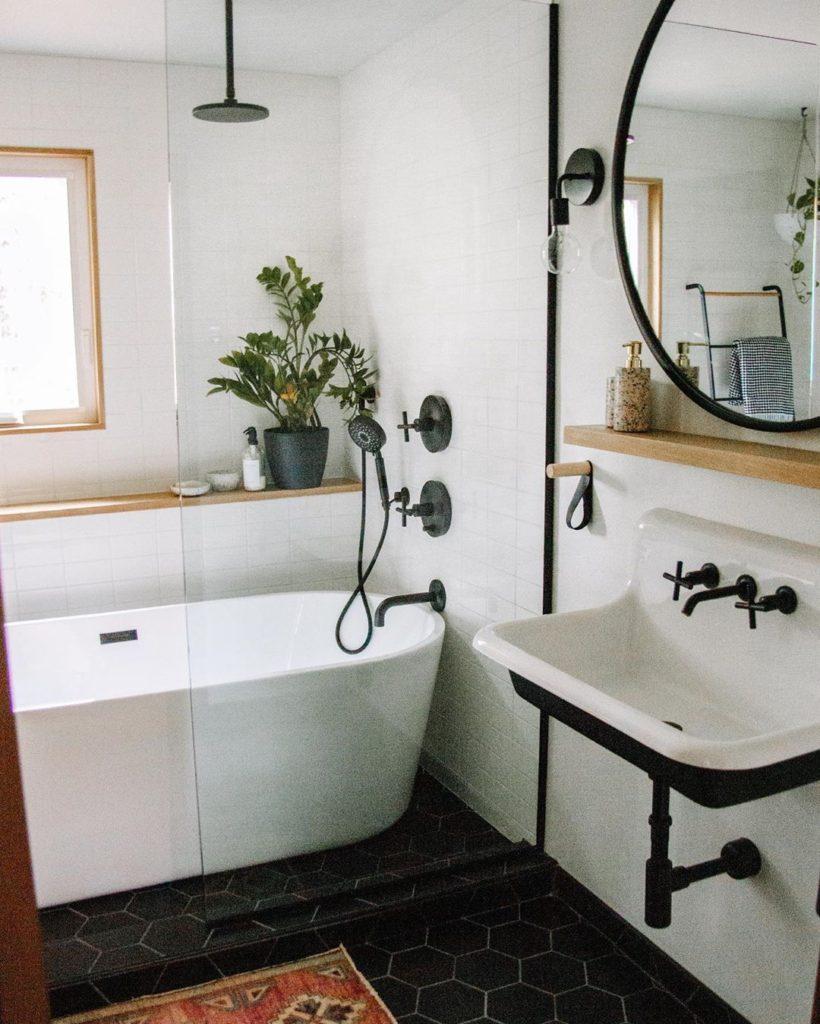 black hexagon floors with subway tiles on walls bathroom and matte black fixtures Bathroom Lighting Ideas