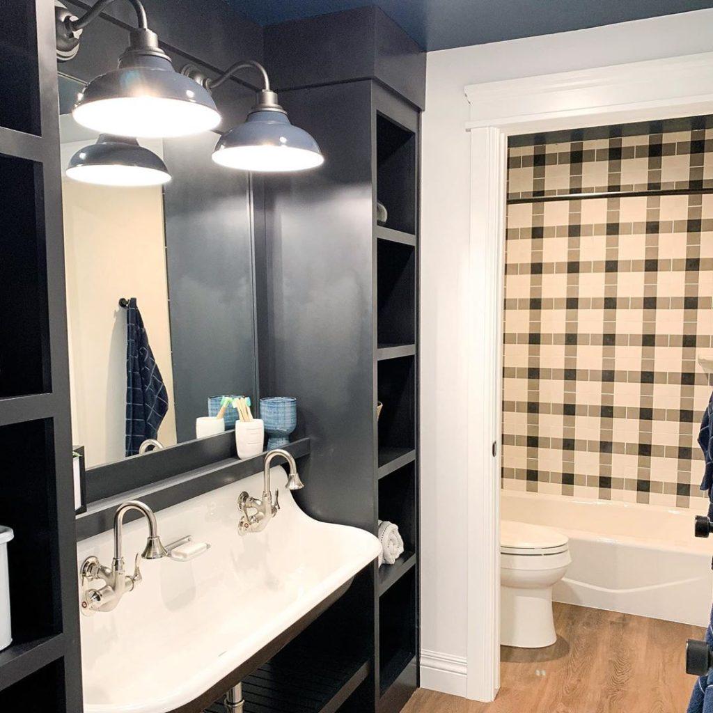 farmhouse bathroom with navy blue walls Bathroom Lighting Ideas