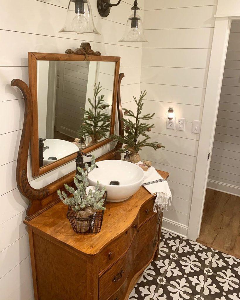 rustic bathroom with Christmas decoration and shiplap walls Bathroom Lighting Ideas