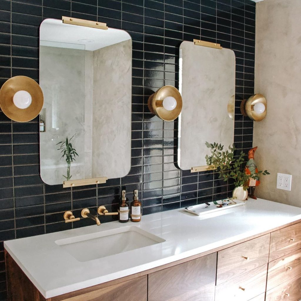 Art Deco style bathroom with black and gold accents and lime washed walls Bathroom Lighting Ideas