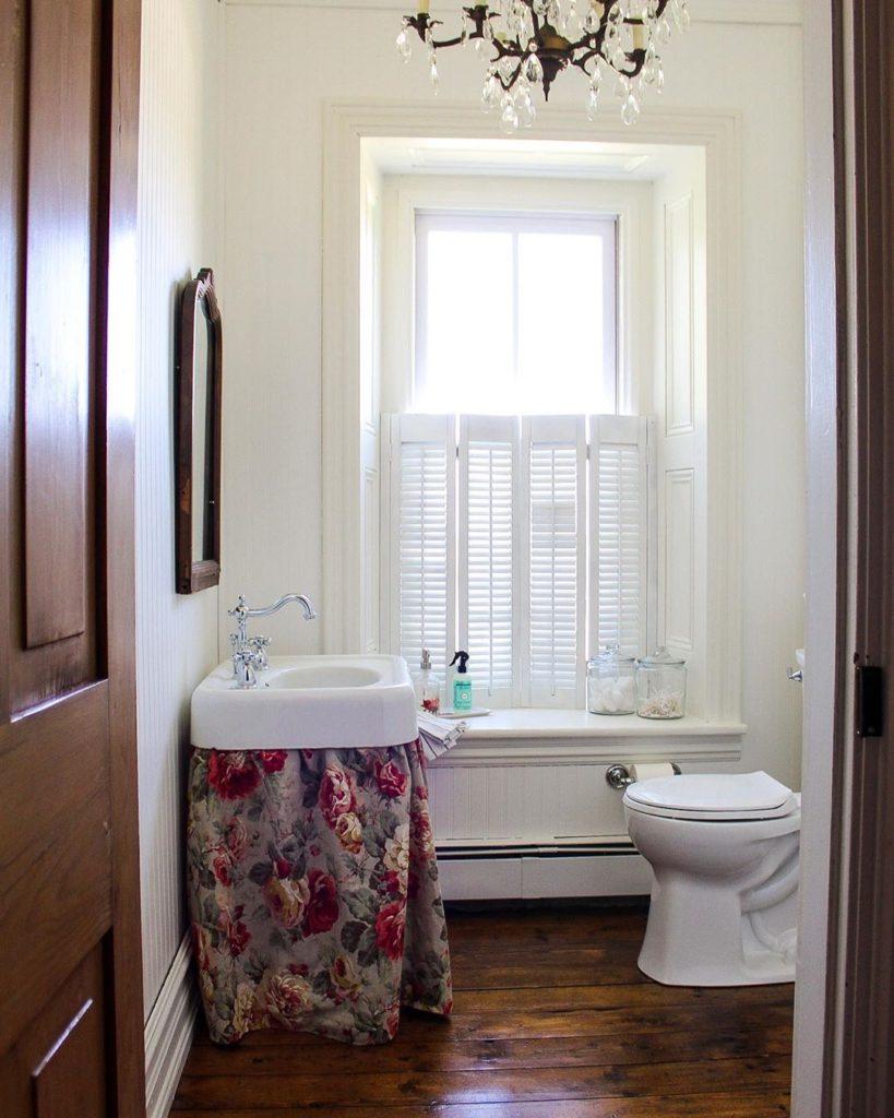 Guest bathroom with flower drape vanity
