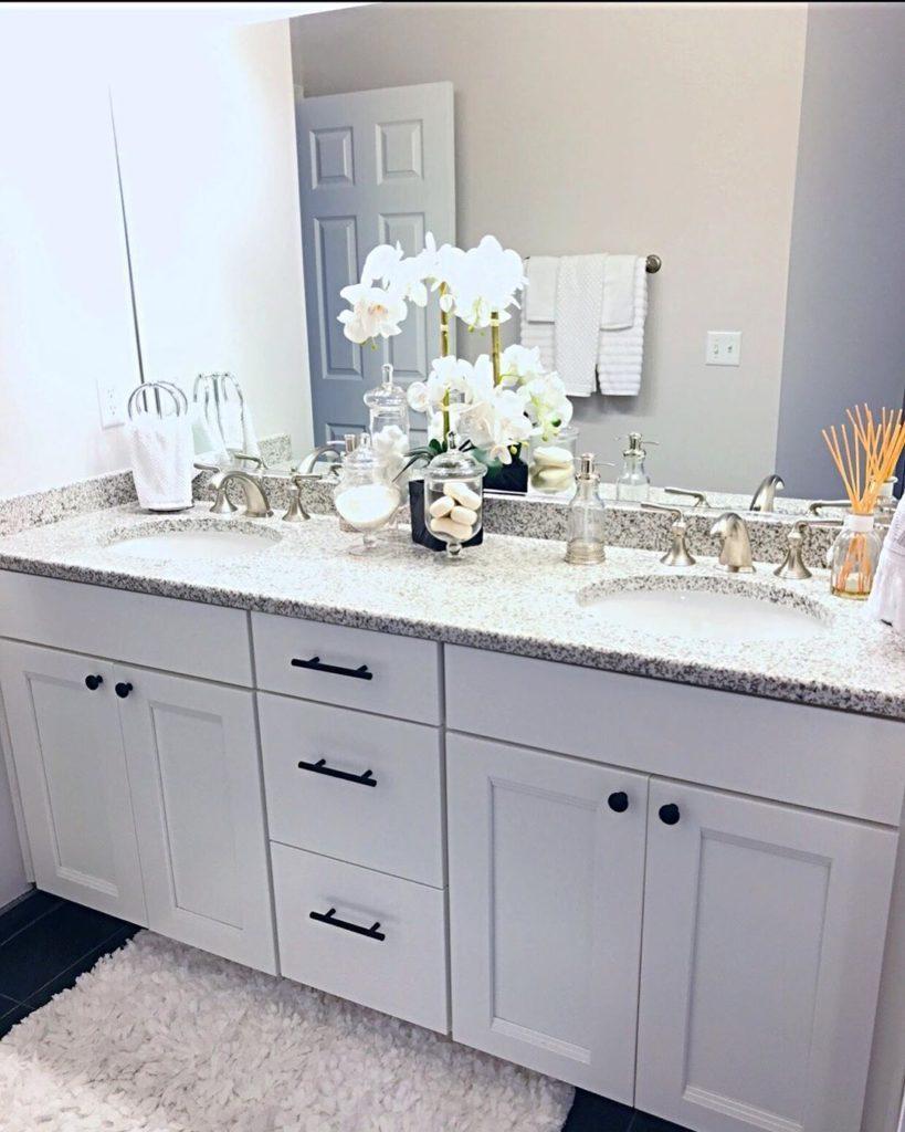 double white vanity iwth marble countertop