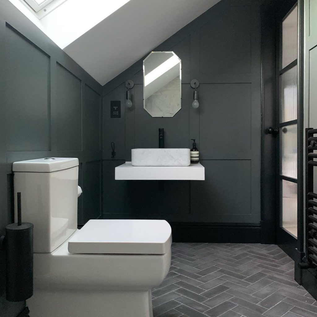 gray bathroom with charcoal walls and subway tie floors guest bathroom