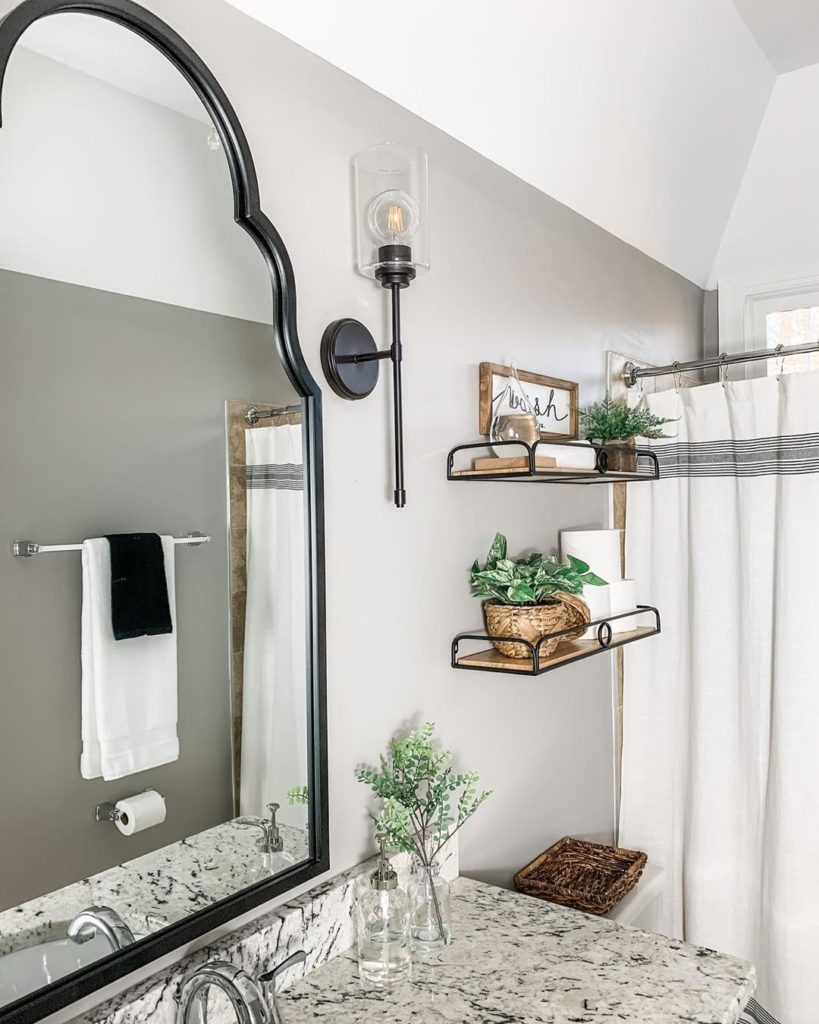 gray bathroom with granite countertop and rustic shelves