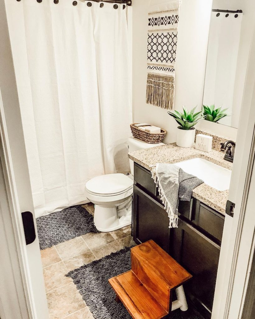 guest bathroom idea of country home with white shower curtains
