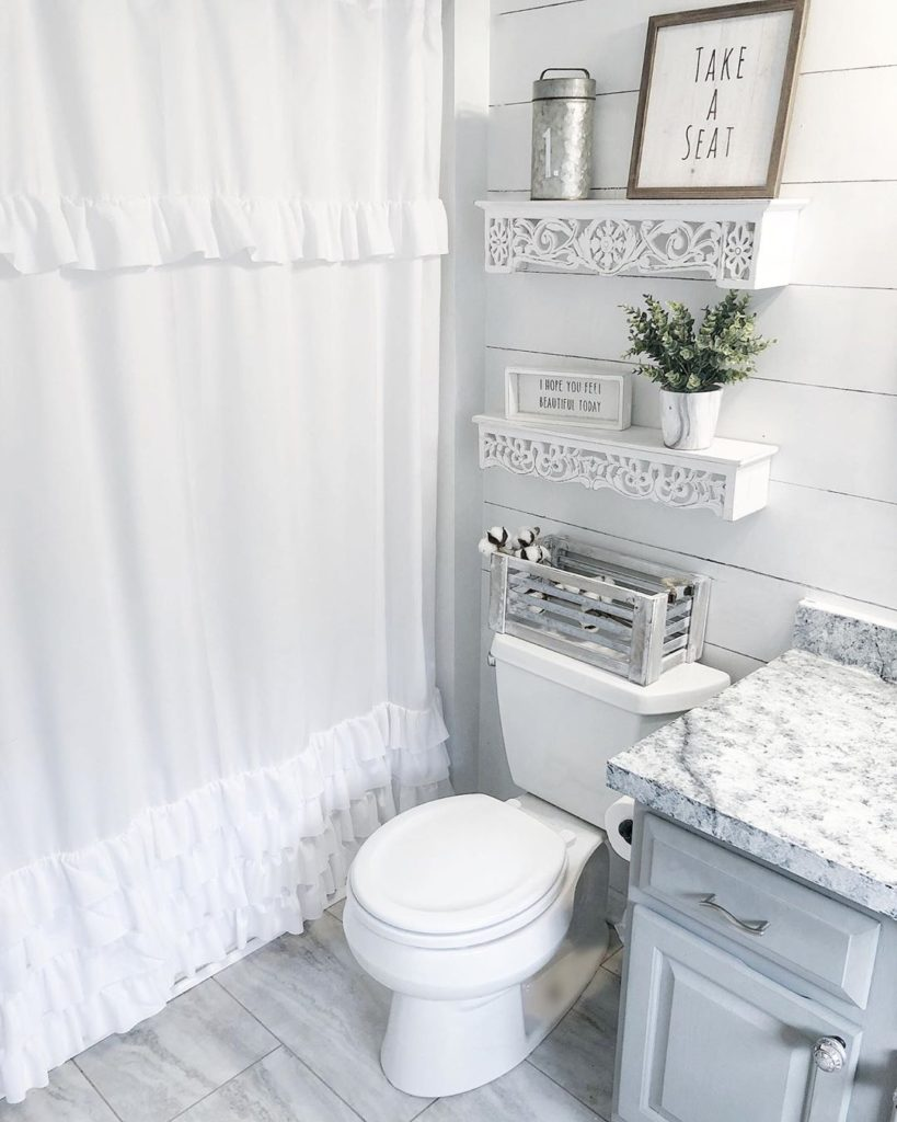 guest bathroom in gray with marble floors and shiplap walls