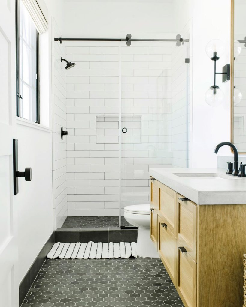 guest bathroom with charcoal gray floor and subway tile
