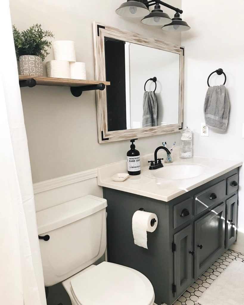 guest bathroom with charcoal vaniy and rustic shelf