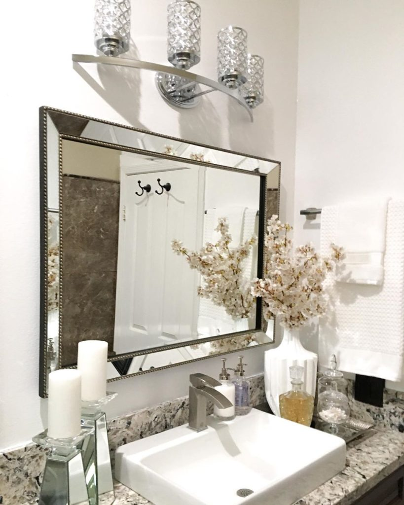 regal guest bathroom with flowers and sink