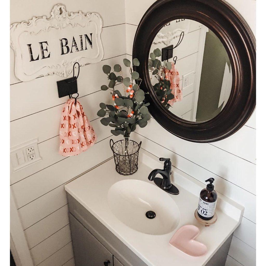 shiplap wall guest bathroom gray vanity bronze mirror