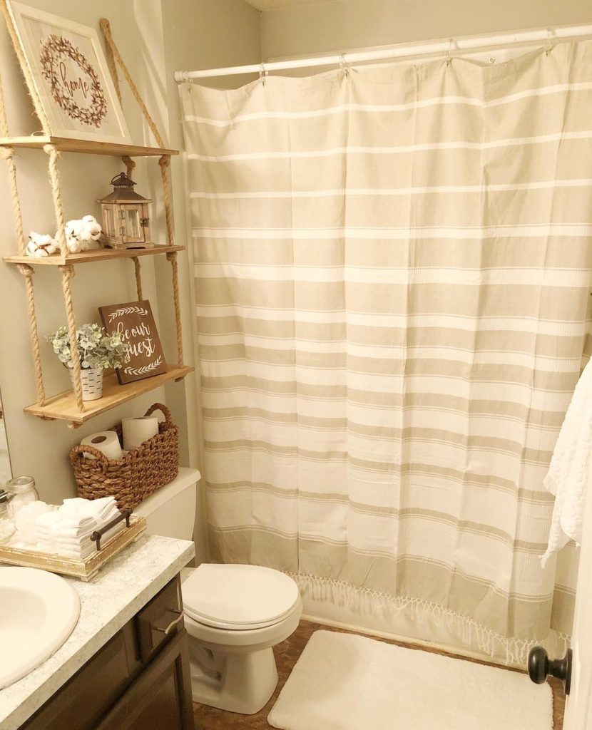 tan and cream colored guest bathroom in neutral
