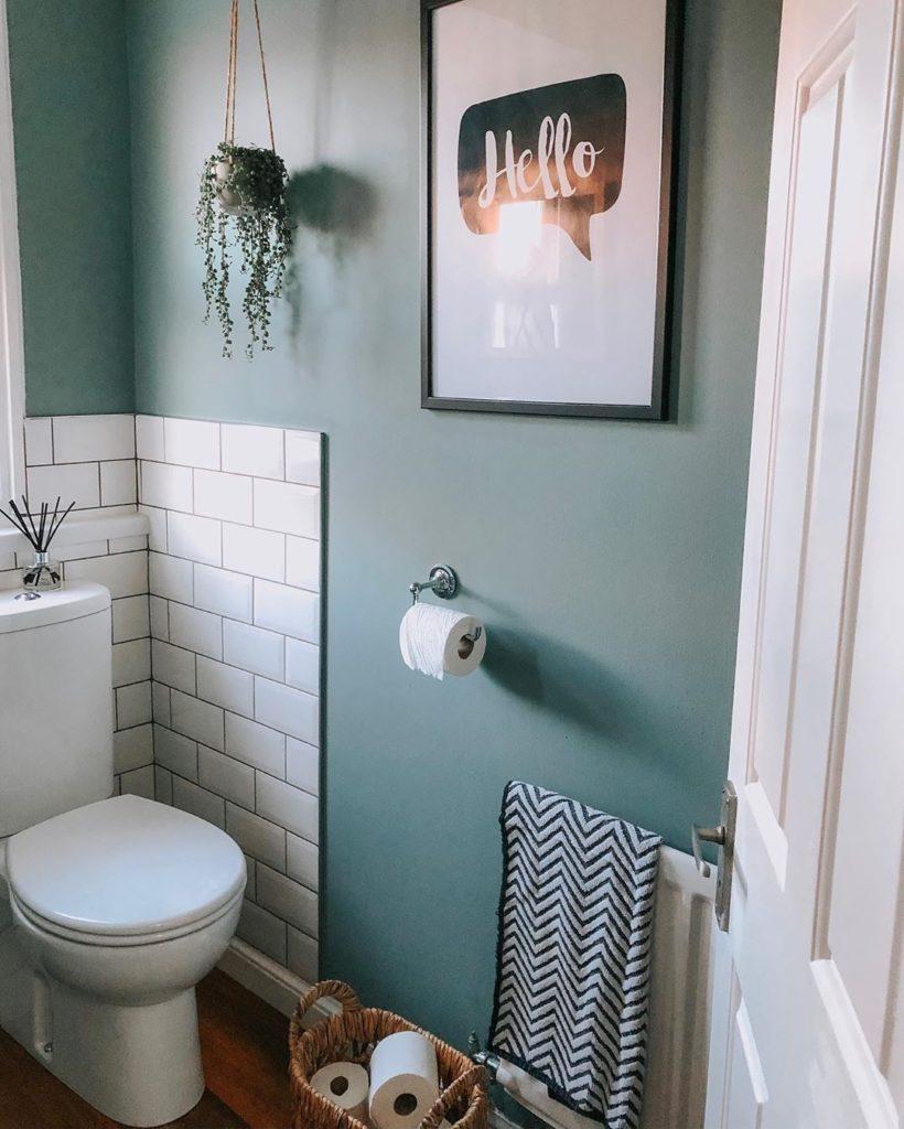 teal bathroom with subway tile
