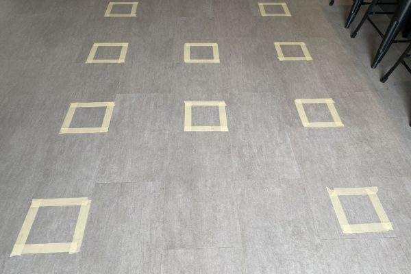 Taped squares on floor to prepare testing of natural cleaners