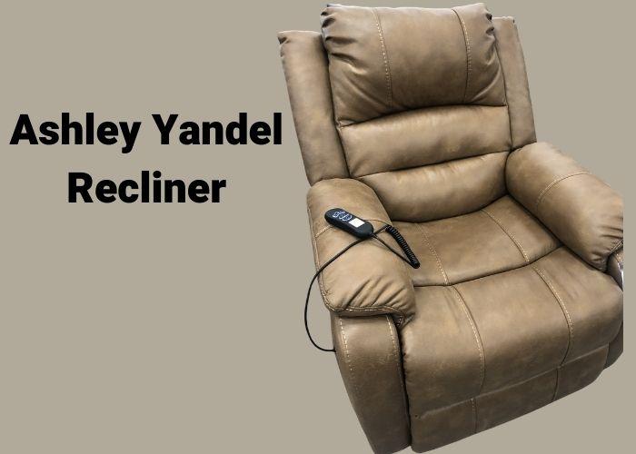 Ashley Yandel recliner being tested for comfort