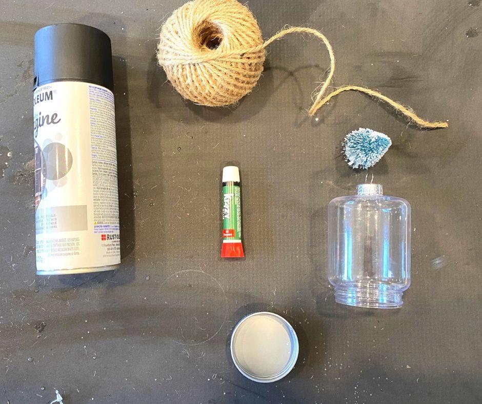 Twine , super glue, plastic mason jar, and matte black spray paint for diy rustic style christmas ornament