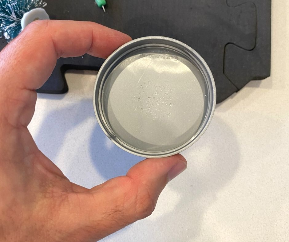 small plastic mason jar lid with crazy glue on it
