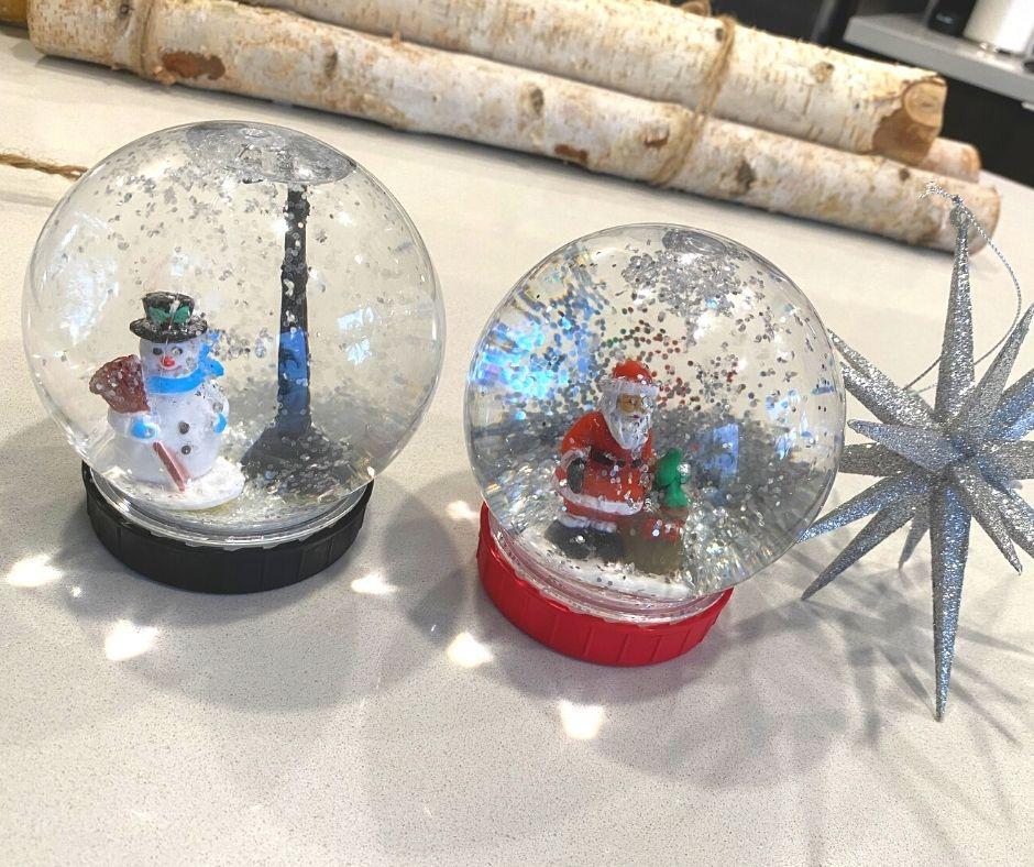 DIY Snow globes with santa and snowman inside