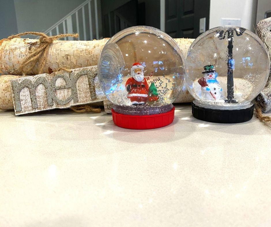 diy snow globes on display red and black with snowman and santa