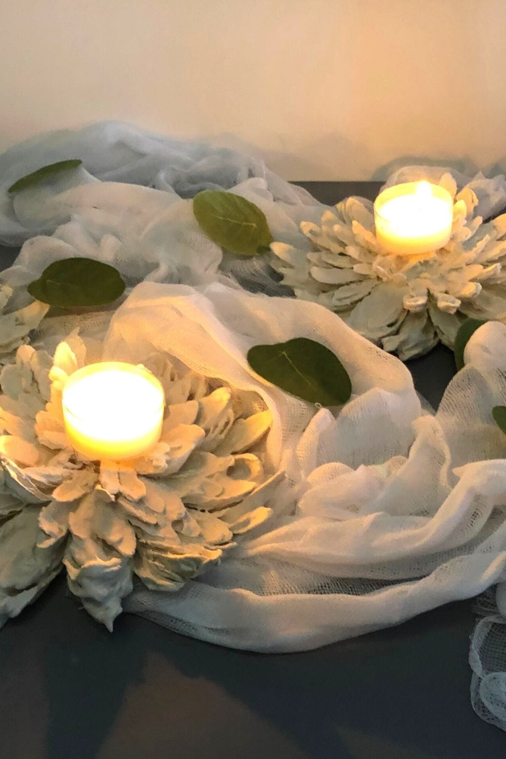 palster of paris flowers with tea lights