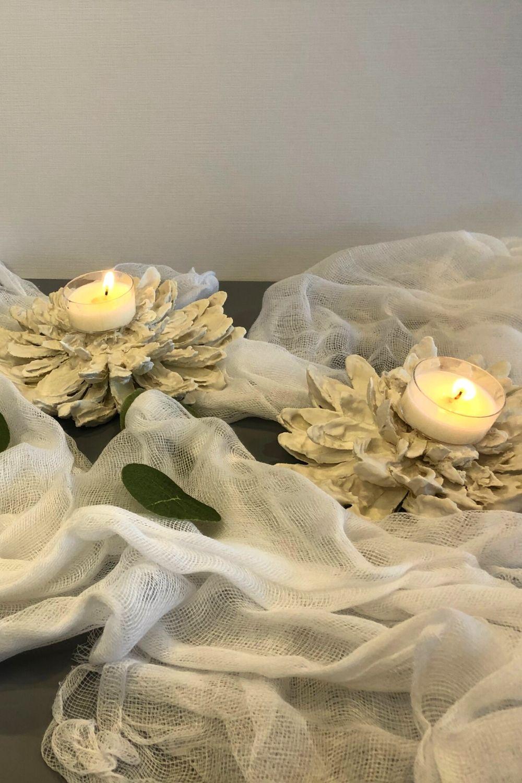 Plaster of paris flowers with tea lights on them