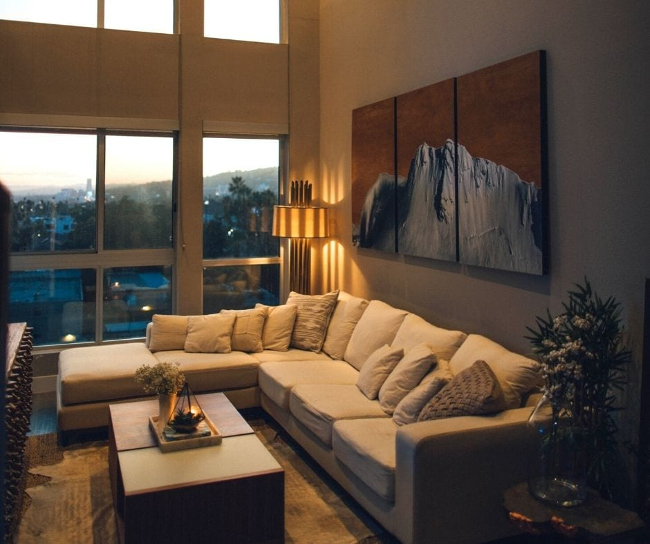 make a room bigger with low based furniture
