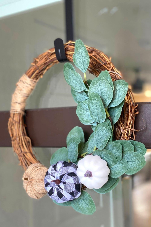 diy farmhouse wreath hanging on front door