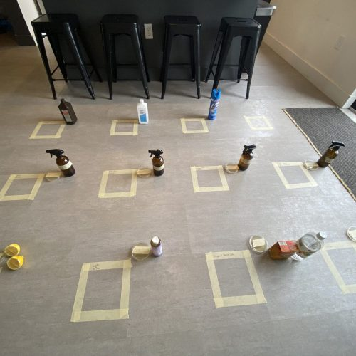 Various squares tape on floor to separate natural cleaner test